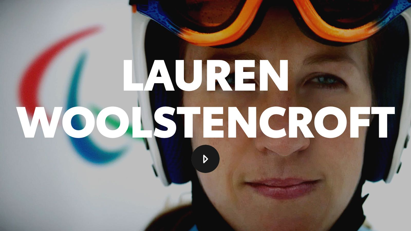 Lauren, wearing her crash helmet with her goggles pulled up, stares into the camera, ready to race.