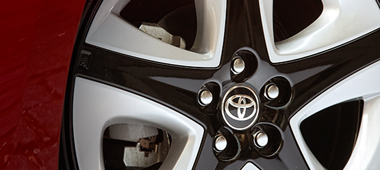Toyota Prius, exterior, close-up of white & black wheel.