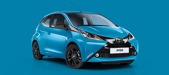 Toyota AYGO, exterior front side view, blue on blue background
