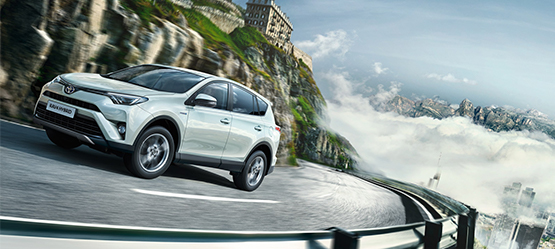 Toyota RAV4, white on mountain road