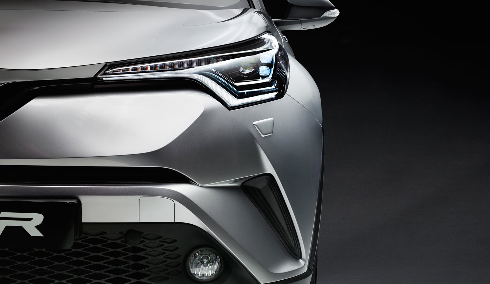 Toyota C-HR, close-up of front left headlight.