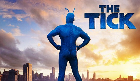 the Tick super hero with city scene in background