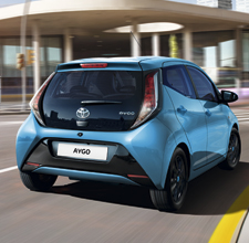 Toyota Aygo, exterior, side back view, Blue, daytime driving shot in city