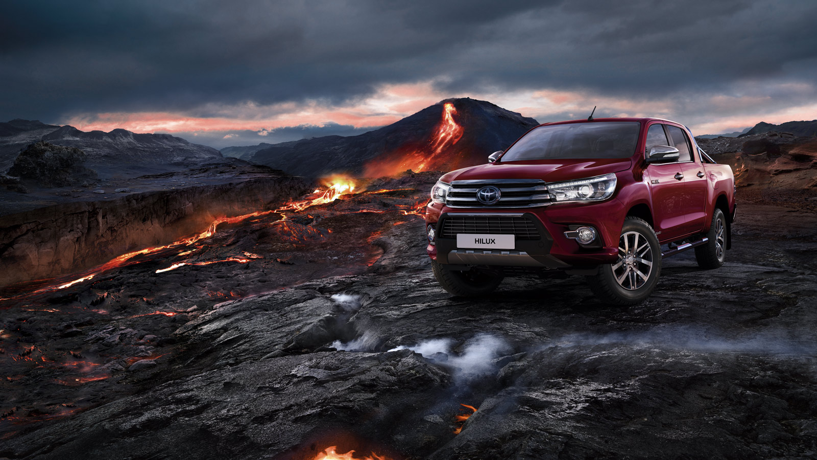 Hilux, Red exterior, front side view, volcano background, night-time shot.