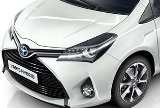 Toyota Yaris, exterior front side view, White and Black colour scheme, white background
