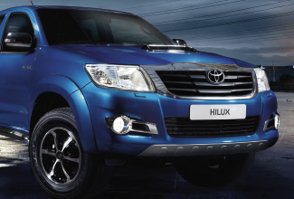 Hilux 4x4, Blue exterior, front view, night shot, action shot