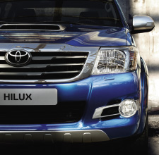 Hilux 4x4, Blue exterior, front view, close up, street shot