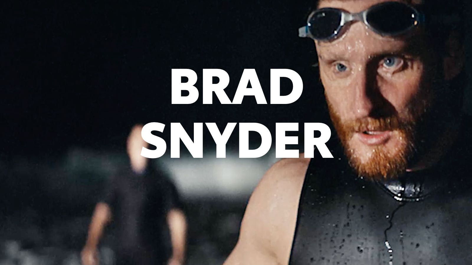 Although he lost his sight in battle, Brad Snyder directs his eyes up and away as if looking toward a podium with his goggles on his forehead.